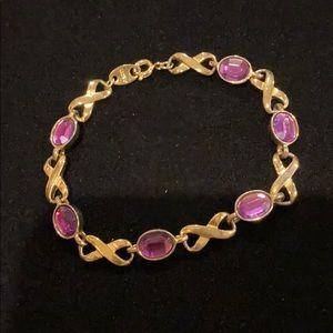 Avon infinity purple bracelet